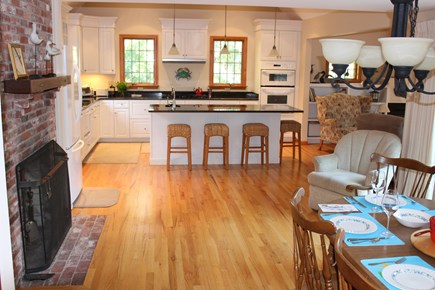 Eastham Cape Cod vacation rental - Original brick fireplace adds character to the open floor plan.