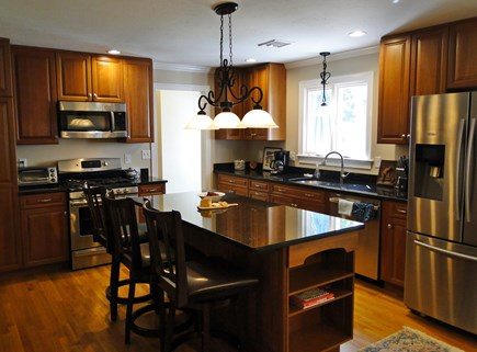 Yarmouth Cape Cod vacation rental - Modern kitchen with stainless steel appliances and breakfast bar
