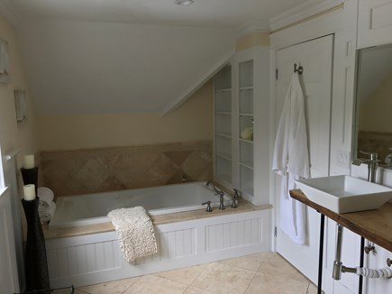 East Falmouth Cape Cod vacation rental - Master bathroom w/spa tub, dual oak vanity and multi spray shower