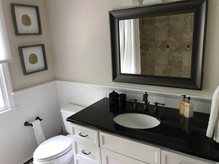 East Falmouth Cape Cod vacation rental - Hall bathroom w/ granite vanity and stone tub/shower