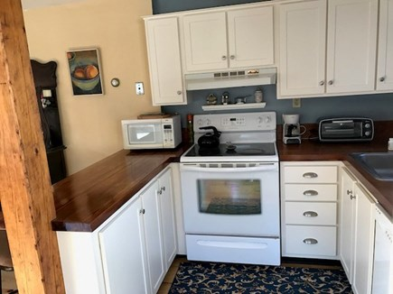 Eastham Cape Cod vacation rental - Kitchen has refinished cabinets.  Refrigerator & sink to right.