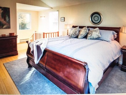 Eastham Cape Cod vacation rental - View of the first floor master bedroom toward the ensuite bath.