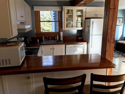 Eastham Cape Cod vacation rental - Efficient kitchen with upgraded cabinets and counter bar.