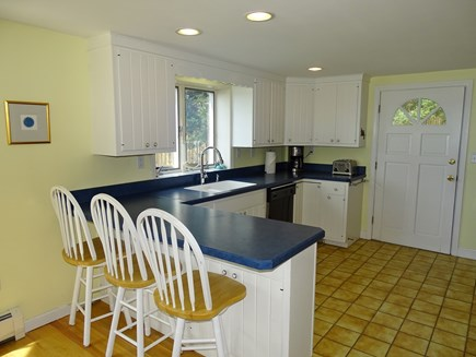 Eastham / Orleans Cape Cod vacation rental - Dining area opens to kitchen with breakfast bar
