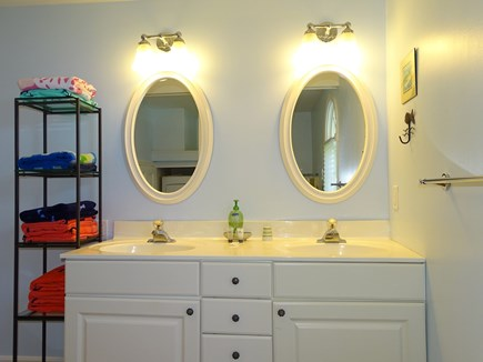 Eastham / Orleans Cape Cod vacation rental - Main floor bathroom with shower, laundry area