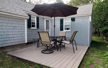 Dennis Port Cape Cod vacation rental - Deck with outdoor dining area and charcoal grill  Outdoor shower.