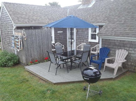 Dennis Port Cape Cod vacation rental - Rear deck with outside shower, dining area and charcoal grill