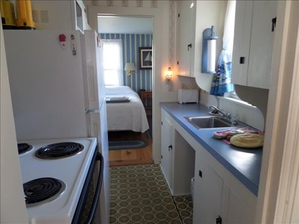 Dennis Port Cape Cod vacation rental - Kitchen, full size stove, refrigerator & microwave.
