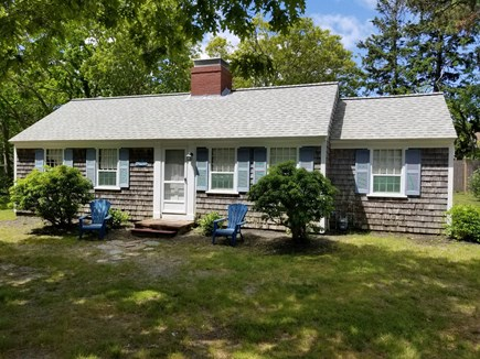 Dennisport Cape Cod vacation rental - Exterior view of cottage w/large front yard area