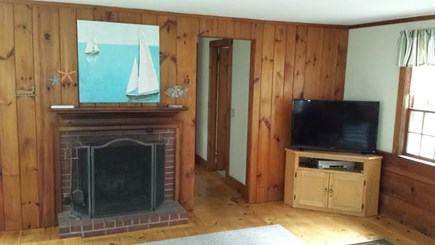 Dennisport Cape Cod vacation rental - Living room with wood burning fireplace