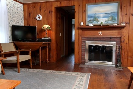 Dennisport Cape Cod vacation rental - Living room with wood burning fire place