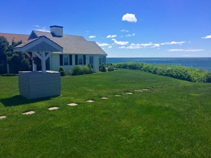 Dennis Port Cape Cod vacation rental - Exterior cottage overlooking Nantucket Sound. Manicured grounds