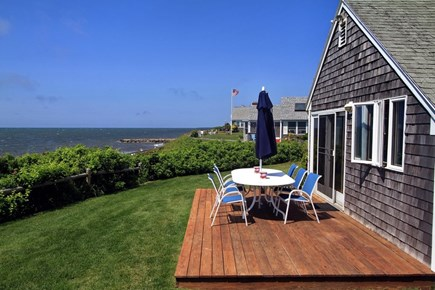 Dennis Port Cape Cod vacation rental - Oceanfront dining, outdoor shower and grill.