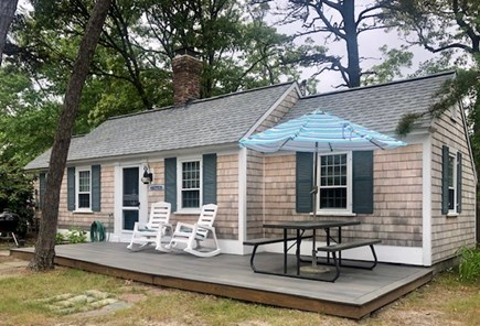 Dennis Port Cape Cod vacation rental - Outdoor dining, charcoal grill and beach chairs provided.