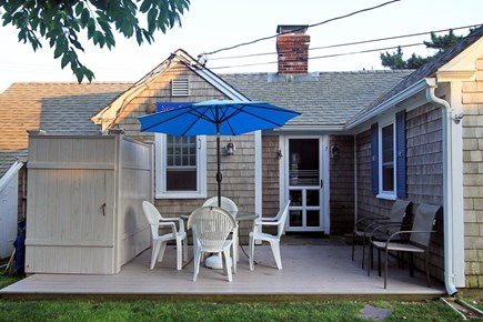 Dennis Port Cape Cod vacation rental - Rear deck and outdoor shower. Manicured grass surrounding cottage