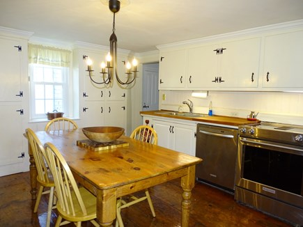 Dennis Cape Cod vacation rental - Second kitchen w/ another dining table, door to back yard, grill