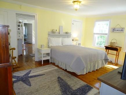 Dennis Cape Cod vacation rental - Main floor master bedroom – queen bed and TV
