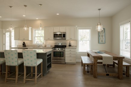 Dennis, Mayflower Beach Cape Cod vacation rental - Kitchen and dining area-open to den