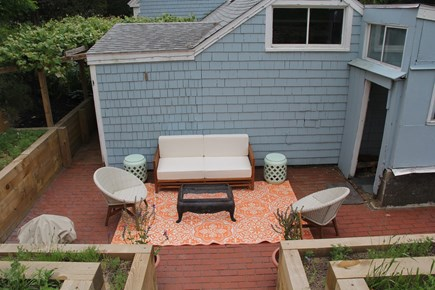 North Truro Cape Cod vacation rental - The sunny back patio has a fire pit for smores