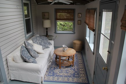 North Truro Cape Cod vacation rental - The comfy porch overlooks the hill that slopes down to the street