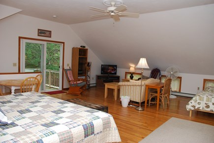 Dennis Village Cape Cod vacation rental - Carriage room with King bed, two twin beds, sitting area with tv