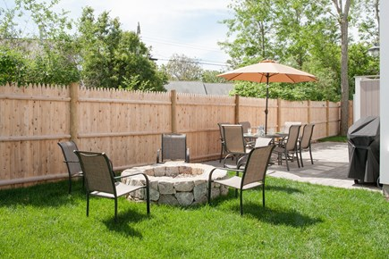 Dennis, Mayflower Beach Cape Cod vacation rental - Back patio with table & chairs, grill, outdoor shower & fire pit