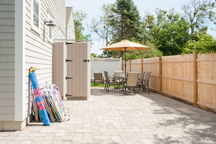 Dennis, Mayflower Beach Cape Cod vacation rental - Back Patio with enclosed outdoor shower & table for 8