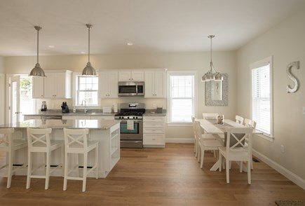 Dennis, Mayflower Beach Cape Cod vacation rental - Kitchen and dining area- open to den