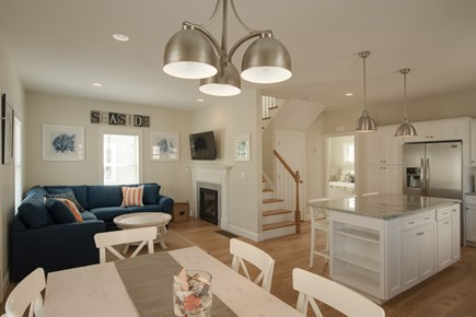 Dennis, Mayflower Beach Cape Cod vacation rental - First floor den with TV, and gas fireplace- open to kitchen