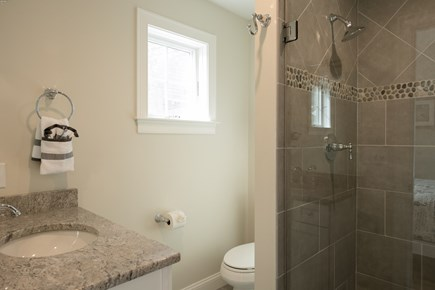 Dennis, Mayflower Beach Cape Cod vacation rental - Master bathroom with tile shower with glass door