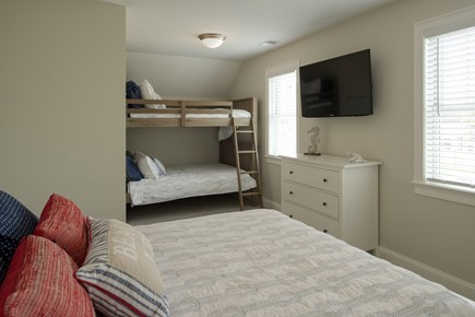 Dennis, Mayflower Beach Cape Cod vacation rental - Second floor bunk room with queen, and double over double bunks