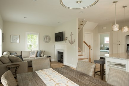Dennis, Mayflower Beach Cape Cod vacation rental - First floor den with gas fireplace and TV-open to kitchen