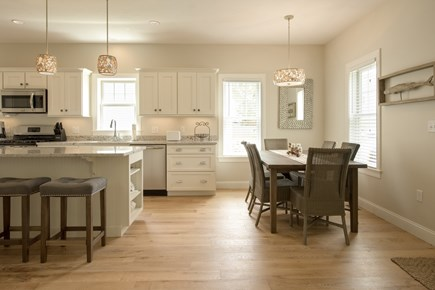 Dennis, Mayflower Beach Cape Cod vacation rental - Kitchen and dining area with 8 chairs-open to den