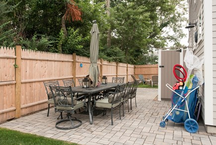 Dennis, Mayflower Beach Cape Cod vacation rental - Back patio with enclosed shower, gas grill, and table & chairs