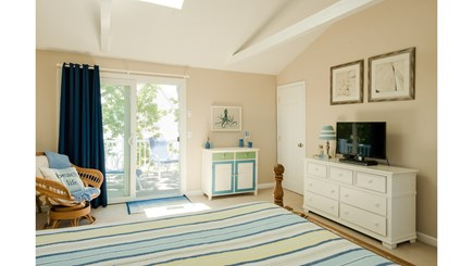 Dennis, Mayflower Beach Cape Cod vacation rental - Second floor Master bedroom with king bed & slider to upper deck