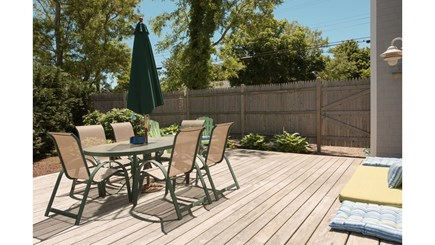 Dennis, Mayflower Beach Cape Cod vacation rental - First floor deck with grill, enclosed shower, and table & chairs