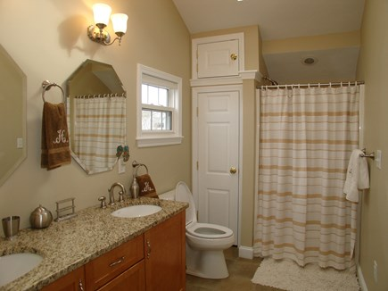 Dennis, Mayflower Beach Cape Cod vacation rental - Guest bathroom with laundry