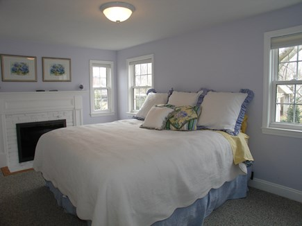 Dennis, Mayflower Beach Cape Cod vacation rental - Bight Master bedroom with gas fireplace, TV, and private bathroom