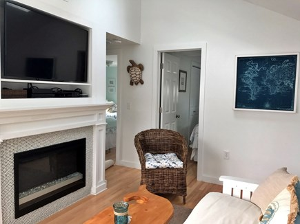 Dennisport Cape Cod vacation rental - 42 inch TV with DVD player and fireplace in living room