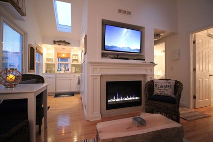 Dennisport Cape Cod vacation rental - View of inside cottage at night.  Modern & cozy. Slider to deck.