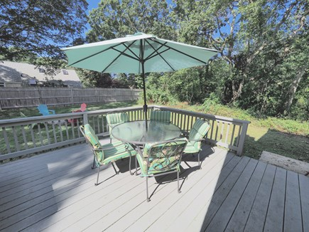 West Yarmouth Cape Cod vacation rental - Spacious yard with deck, fire pit, gas grill, and outdoor shower