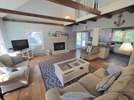 West Yarmouth Cape Cod vacation rental - Fireplace and TV in living room with plenty of seating