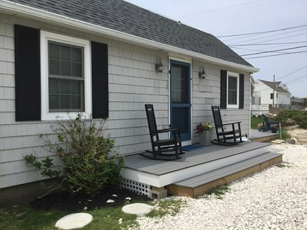 Dennis, Mid Cape Area Cape Cod vacation rental - Morning coffe on the porch with a water view .