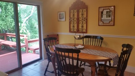 Chatham, Near downtown Cape Cod vacation rental - Dining area with slider to huge deck