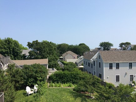 Provincetown Cape Cod vacation rental - View from deck, overlooking yard and harbor in the distance