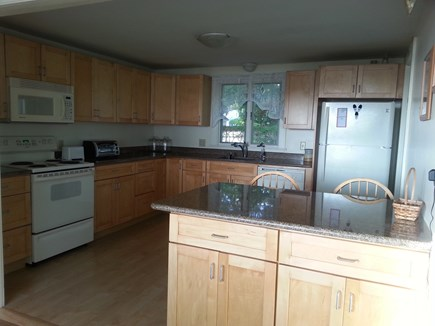 Falmouth Cape Cod vacation rental - Kitchen with maple cabinets and granite counters.