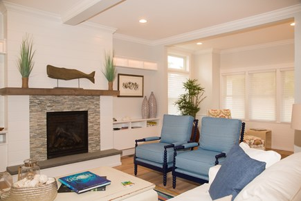 Brewster Cape Cod vacation rental - The living room with gas fireplace and reading chair in nook