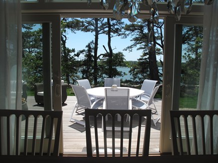 Brewster Cape Cod vacation rental - Outdoor dining for 6 with umbrella overlooking the pond
