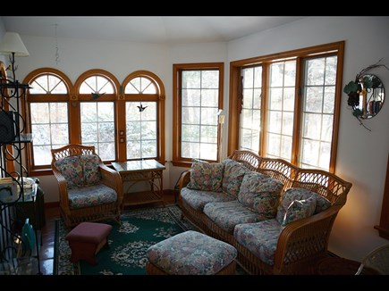 South Wellfleet Cape Cod vacation rental - The Sunroom, with beautiful views, lies off of the Dining Room.