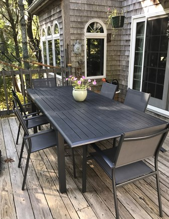 South Wellfleet Cape Cod vacation rental - A large family table on the deck